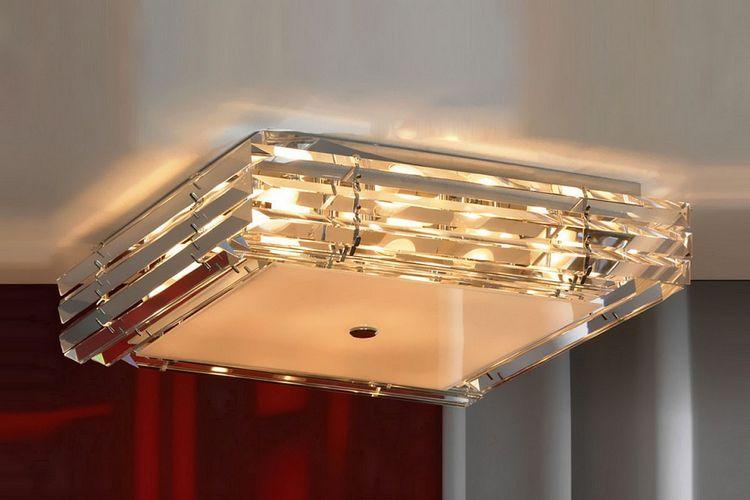 Цікаві приклади люстр для натяжної стелі в залі